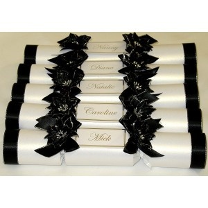 Luxury handmade wedding crackers with foil printed name cards.