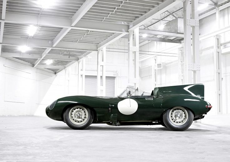 The Jaguar D-Type race car (1955 model shown) was a Le Mans winner and predecessor to the ...