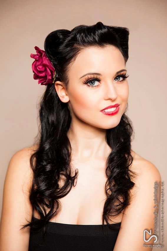 Pin up style. Curls pinned with a flower.