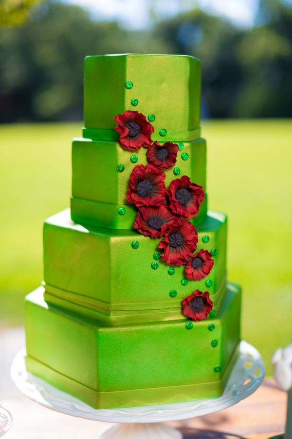 Emerald green cake with red poppies, inspired by The Wizard of Oz.