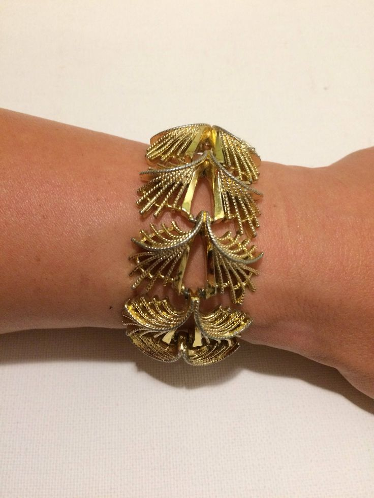 A personal favourite from my Etsy shop https://www.etsy.com/uk/listing/531835842/art-deco-bracelet-gold-bracelet-yellow