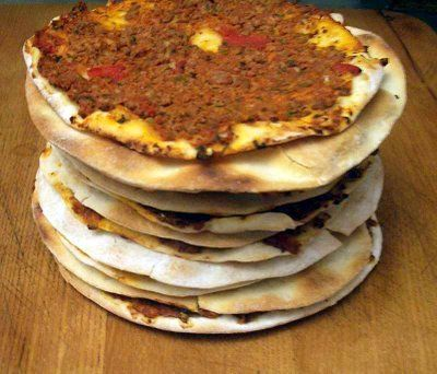 Lahmajoun (Armenian meat pie). Very popular in Lebanese communities. It has a very thin crust and flavorful meat topping...seriously yummy!