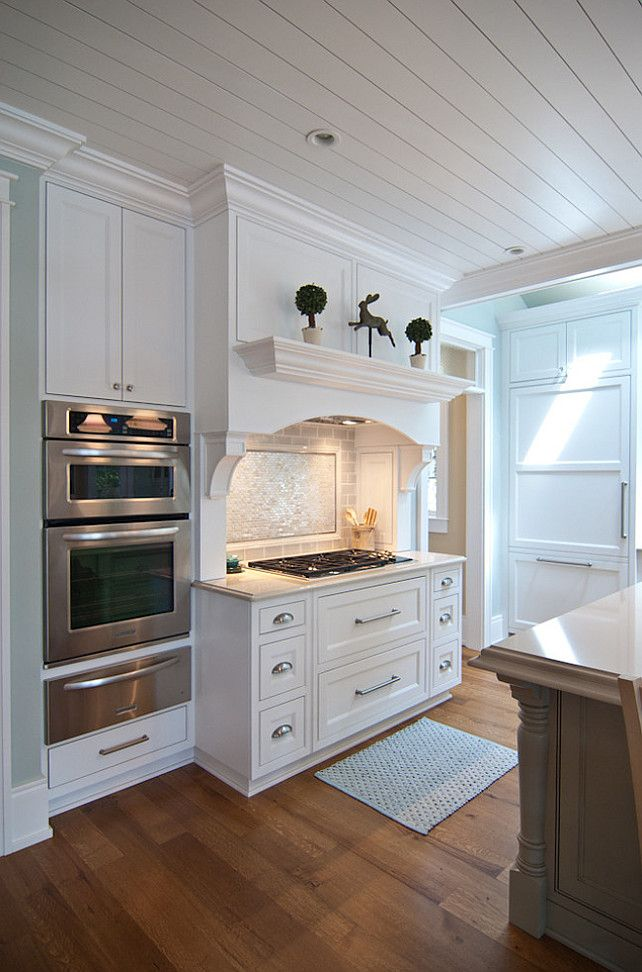 Beach cottage-y feel is added to the kitchen with the tongue and groove ceiling.East Coast Inspired Shingle Home