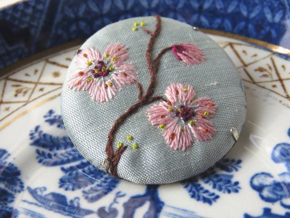 Inspired by the beautiful cherry blossoms around at the moment this beautiful brooch is stitched in shades of pink on a soft pale blue