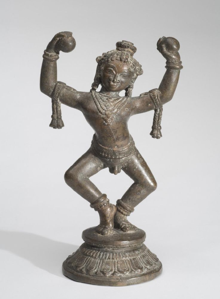 Philadelphia Museum of Art - Collections Object : Krishna Dances and Holds Aloft Two Stolen Balls of Butter Geography: Made in Odisha, India, Asia Date: c. 17th century Medium: Copper alloy Dimensions: 8 1/2 × 5 × 3 3/8 inches (21.6 × 12.7 × 8.6 cm) Curatorial Department: South Asian Art Object Location: Currently not on view  Accession Number: 1994-148-262 Credit Line: Stella Kramrisch Collection, 1994
