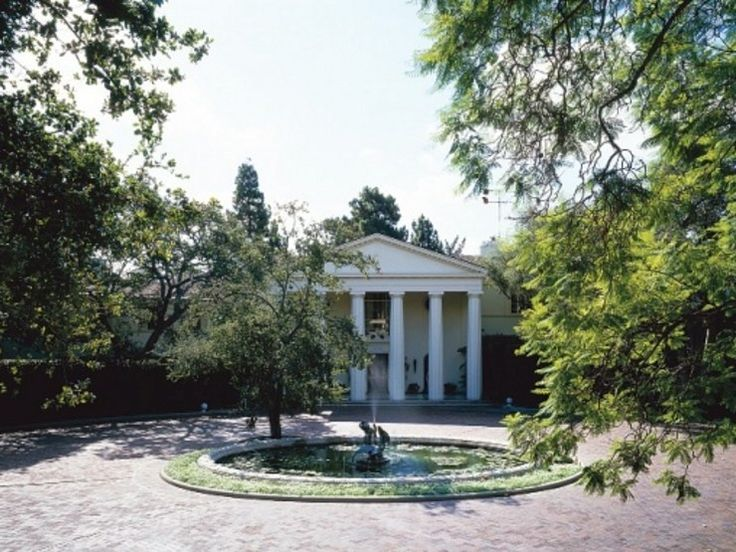 "The front drive of Jack L. Warner's Beverly Hills estate. ""I am what I am, and I…"