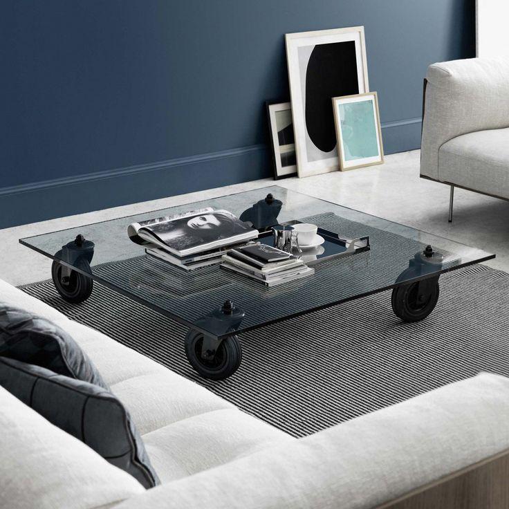 Tavolo Con Ruote, soffbord från Fontana Arte med 15 mm tjock glasskiva och hjul i industriellt utförande.