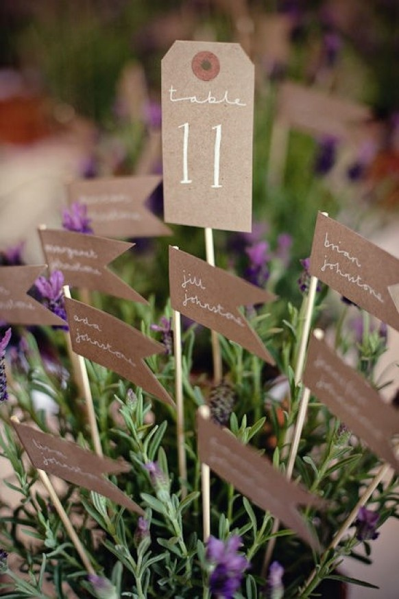 Table number with their guests in a lavender plant. Visit www.rosetintmywedding.co.uk for bespoke wedding planning and design.