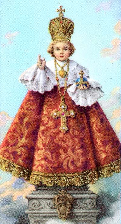 I have been fascinated with the statues of The Infant of Prague found in Catholic churches since I was a little girl.  I loved how his outfits changed many times during the year.