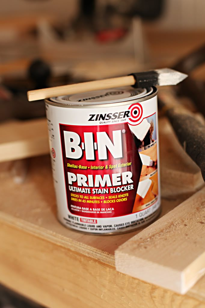 shellac-based primer. sticks to laminate! sticks to everything.