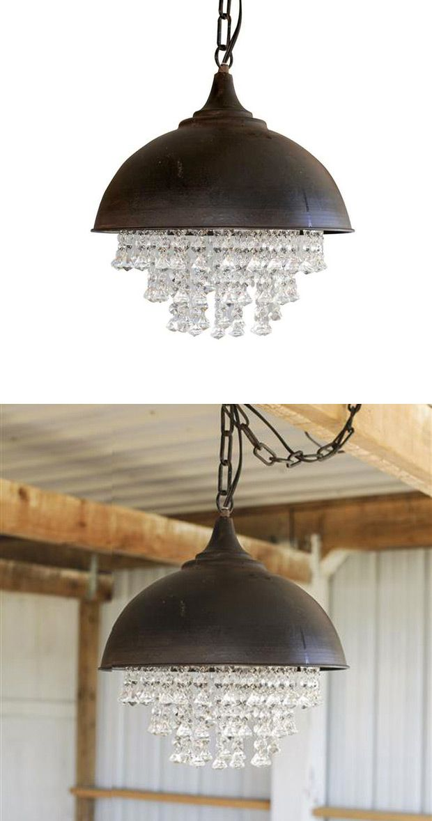 Where rustic meets romance: a perfect juxtaposition of metal and lovely crystals. We love the way these two materials come together to cast pretty light in any room.  Find the Crystal Rock Chandelier, as seen in the Urban Arboretum Collection at http://dotandbo.com/collections/urban-arboretum?utm_source=pinterest&utm_medium=organic&db_sku=CCO0295