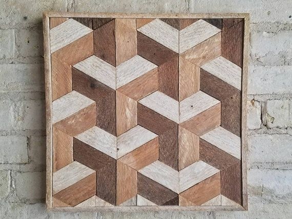 This is a one of a kind wood lath art piece that is 14 1/2 wide by 15 1/4 high and 1.5 deep. The frame is made from the same material. It can be hung from any side you choose. This could also be used as a side table or nightstand if you add legs. It is made from reclaimed lath wood that was originally inside a plaster wall. The wood was naturally aged on one side and the other absorbed some color from the plaster. I kept the natural finish and original nail holes on the wood which brings out…