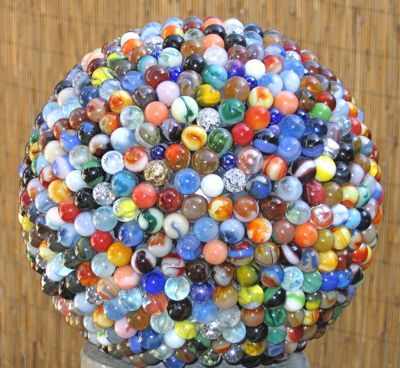 marble garden globe, so cool - and think of how long it would take to glue these marbles on.  I'd be burned from head to toe with the hot glue gun!