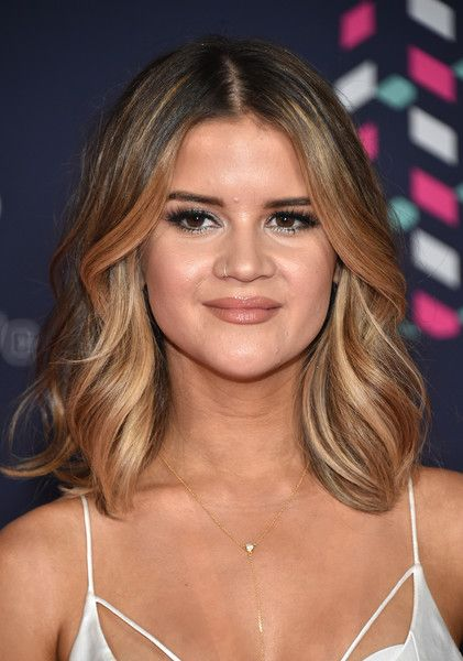 Maren Morris Photos - Musician Maren Morris attends the 2016 CMT Music awards at…