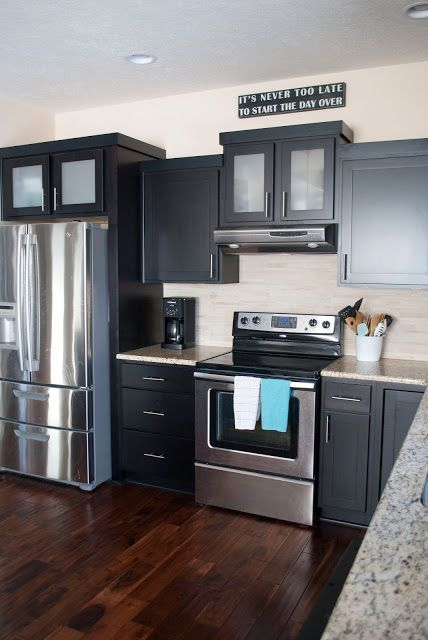 A Kitchen Tour With Contrasting Finishes Such As Dark Cabinets Wood Floors And