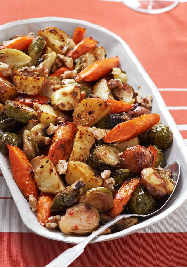 Roasted Winter Vegetable Trio — Opt for this flavorful side dish of Brussels sprouts, carrots and potatoes tossed in a zesty dressing.: