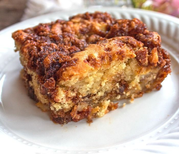 Apple Sour Cream Cake is tender and moist.  With a layer of brown sugar and pecans in the center as well as on top it'll quickly become a favorite.