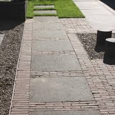 Less brick and more paving preferred but a combination that works well and can provide a contemporary finish (depending on the paving and bricks chosen)