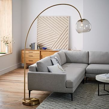 L: This globe looks more hip, but also a pain to clean? Overarching Acrylic Shade Floor Lamp - Antique Brass/Smoke #westelm