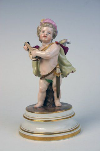 Meissen figure of cupid playing a guitar from a series of 27 figures was first modelled by Heinrich Schwabe c.1880.