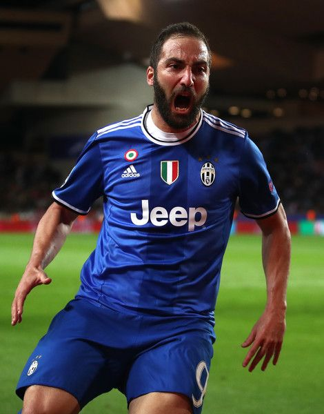 Gonzalo Higuain of Juventus celebrates scoring his sides first goal during the UEFA Champions League Semi Final first leg match between AS Monaco v Juventus at Stade Louis II on May 3, 2017 in Monaco, Monaco.