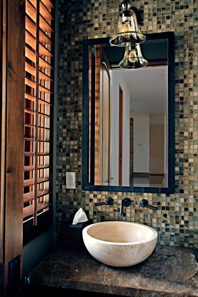 Powder room with mosaic tile feature wall and a natural
