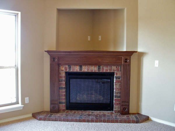i love the feel of this corner fireplace with television nook i would prefer stone