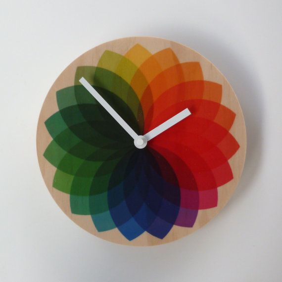 Hey, I found this really awesome Etsy listing at https://www.etsy.com/listing/163677735/objectify-rainbow-fan-wall-clock