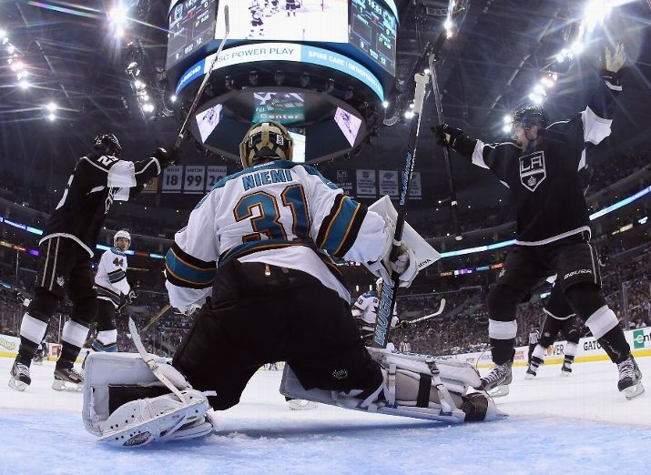 Dustin Penner (L) #25 and Trevor Lewis #22 of the Los Angeles Kings celebrate a goal by Drew Doughty (not pictured), as goaltender Antti Niemi #31 of the San Jose Sharks looks on in the second period of Game Two of the Western Conference Semifinals during the 2013 NHL Stanley Cup Playoffs at Staples Center on May 16, 2013 in Los Angeles, California. The Kings defeated the Sharks 4-3. (Photo by Jeff Gross/Getty Images)