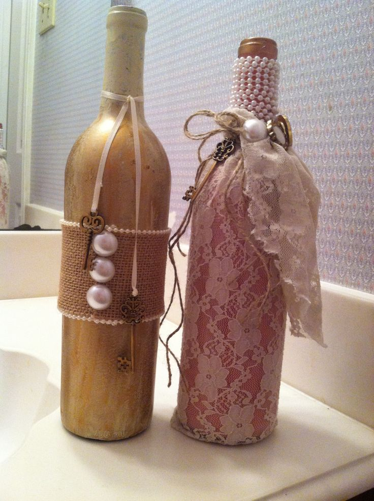 Painted wine bottles with lace and pearls i made for for Painted wine bottle wedding centerpieces