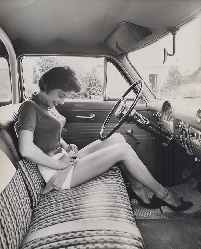 Cars used to have a bench front seat and we stood in the middle with NO seatbelt. Mom would put her arm out at stops so we wouldnt fall!