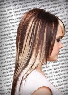 I love the chunky color through out her hair. I'd like to to this with black on top and red in under