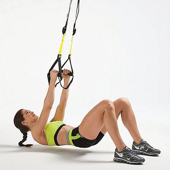 Lie face up under the TRX with knees bent and feet on floor. Hold the handles over your chest, arms extended and palms facing each other. Bend elbows, pulling torso up until your body is aligned from shoulders to knees. Extend arms to starting position. Sets: 3 Reps: 30 seconds More on Shape: Everything You Need to Know About Sugar 5 Reasons Running May NOT Help You Lose Weight