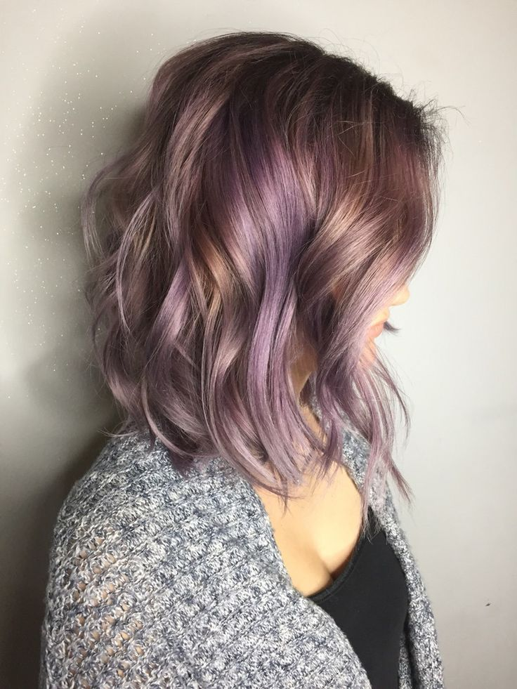 Don't be afraid to leave some of your bleached pieces blonde when you're dying the rest purple to achieve this golden lavender hairstyle. It will add a nice amount of dimension and keep things subtle but still extra rad.