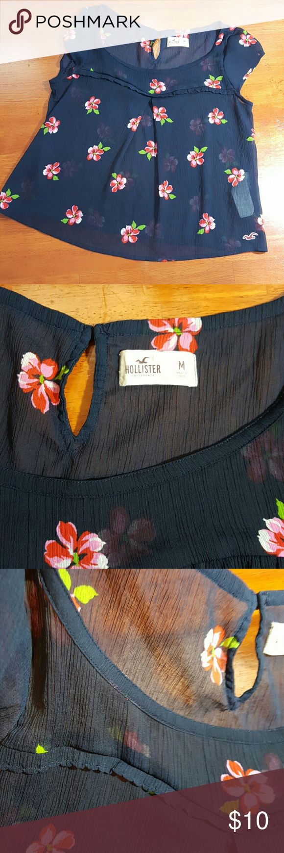Hollister top Blue sheer with multicolor  flowers shortsleeve...in good condition Hollister Tops