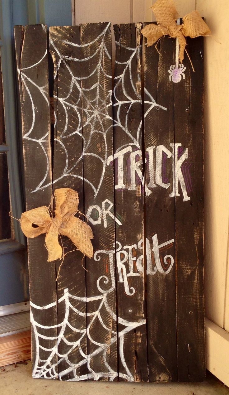 """Hand made """"trick or treat"""" reclaimed wood sign. I would not use the bows. It's simple clean and perfect"""