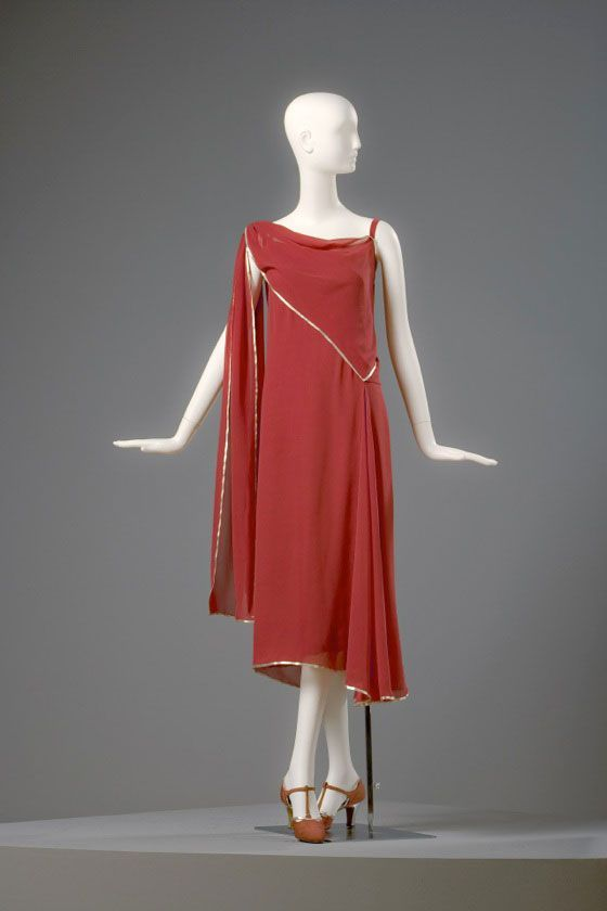 Madeleine Vionnet Dress, 1922 Silk crepe georgette with lamé edging. Arizona Costume Institute . Vionnet, a genius seamstress who built her dresses from the ground up so to speak, by cutting fabric on the bias, directly on her models. The final look was a unique feminine drape which heralded a new look that emphasized freedom of movement and femininity. Even with the popular garcon look [ flat chested and tubular ] the Vionnet dress was unmistakably feminine.