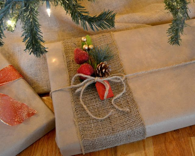 I bought builder paper at Lowes. It is like craft paper but comes on a huge roll. I think it is 100 yards for $8. Pretty cheap wrapping paper that I can use year-around. I dressed up the plain paper with some fun bows & ribbons.