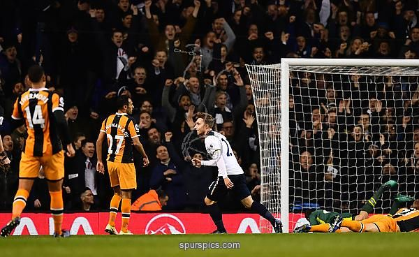 LONDON, ENGLAND - DECEMBER 14: Christian Eriksen of Tottenham Hotspur (C) celebrates scoring his sides first goal during the Premier League match between Tottenham Hotspur and Hull City at White Hart Lane on December 14, 2016 in London, England