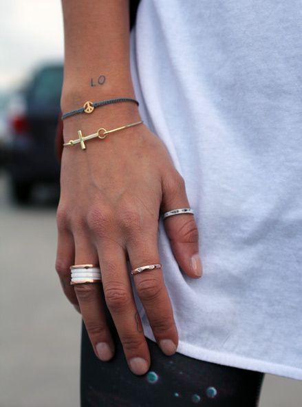cross + peace sign + rings
