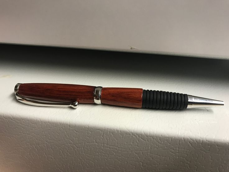 """Rhodium comfort twist pen, blood wood. This one came out a lot better than the black titanium. This kit came with a note to provide to the owner I guess """"This custom hand-turned pen is played with Rhodium, a member of the Platinum Group of precious metals."""""""