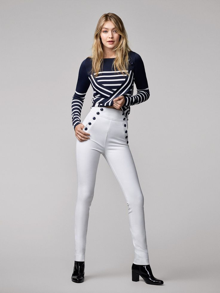 Gigi Hadid's Tommy Hilfiger collaboration includes bomber jackets, skinny high-waisted jeans, nautical jackets and flowing maxi dresses covered with charming miniature prints.