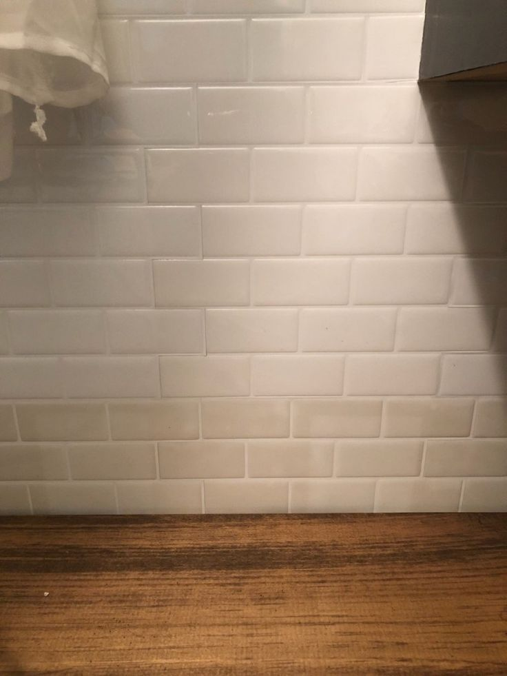 An Honest Review Of My Peel And Stick Tiles One Year Later Stick On Tiles Stick Tile Backsplash Peel And Stick Tile