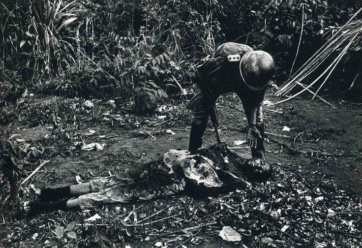 An American troop attends to a fellow G.I. during the Vietnam War. Don McCullin