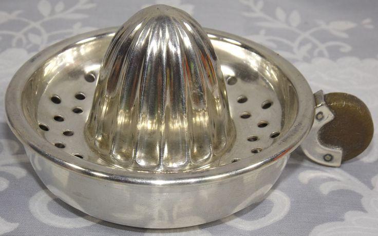 Silver plate with bakelite handle juicer