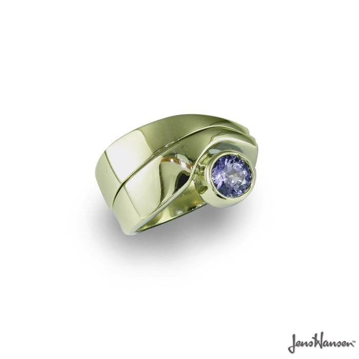 18ct White Gold engagement ring with a 6mm Ceylon Sapphire,  accompanied by matching wedding band. Original design by Jens Hansen.