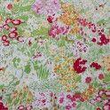 Coton imprimé de motifs champs de fleurs multicolores.