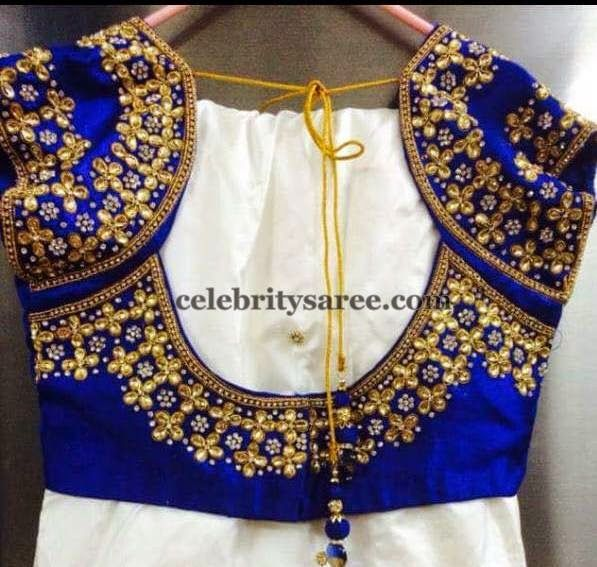 Love everything about this blouse! The deep Royal blue with the dark gold sequins which are perfectly placed to give it a full but not overwhelming look. The short sleeves are so cute too! Love this look for a sangeet or garba - something where the bride is flooding to be dancing a lot and the work will shine. #Indianwedding, #ShaadiShop