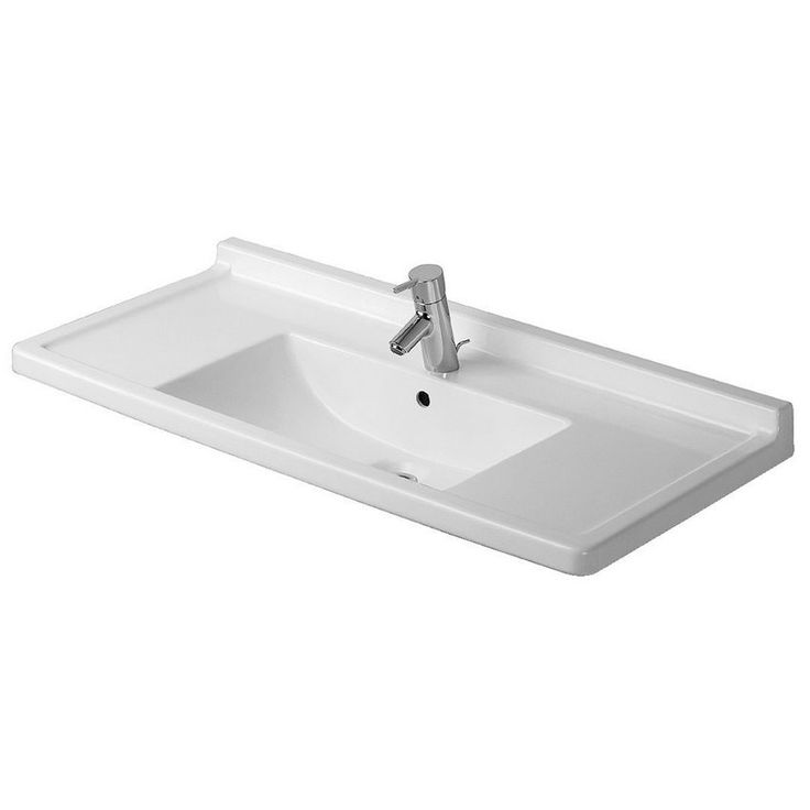 This contemporary white porcelain sink is an excellent choice for any bathroom remodel. The sleek square design and neutral color make this sink able to complement a variety of decors and pair well with faucets of all finishes.
