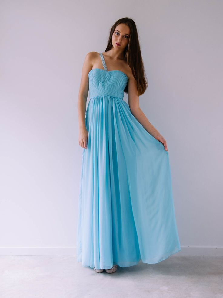 A beautiful strapless gown with leaf embellishment strap over shoulder. Just perfect for a Bridesmaid or Formal Maxi. Chiffon. Dry Clean only